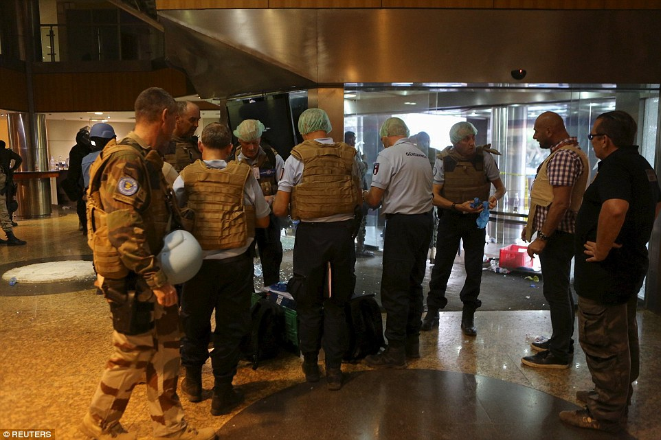 The terrorist group which carried out the killings said it wanted fighters freed from Mali's prisons and for attacks against northern Malians to stop. Pictured:French gendarmes prepare forensic supplies in the lobby of the Radisson hotel in Bamako