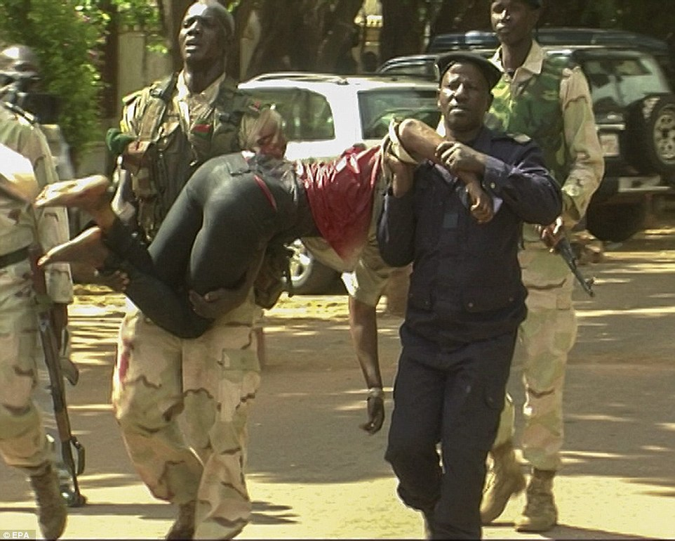 A seriously injured survivor is carried out from the luxury hotel in the Mali capital, Bamako - one of the first to be rescued