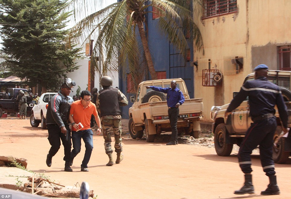 Dozens of hostages remain trapped inside the building despite news that special forces have entered the building