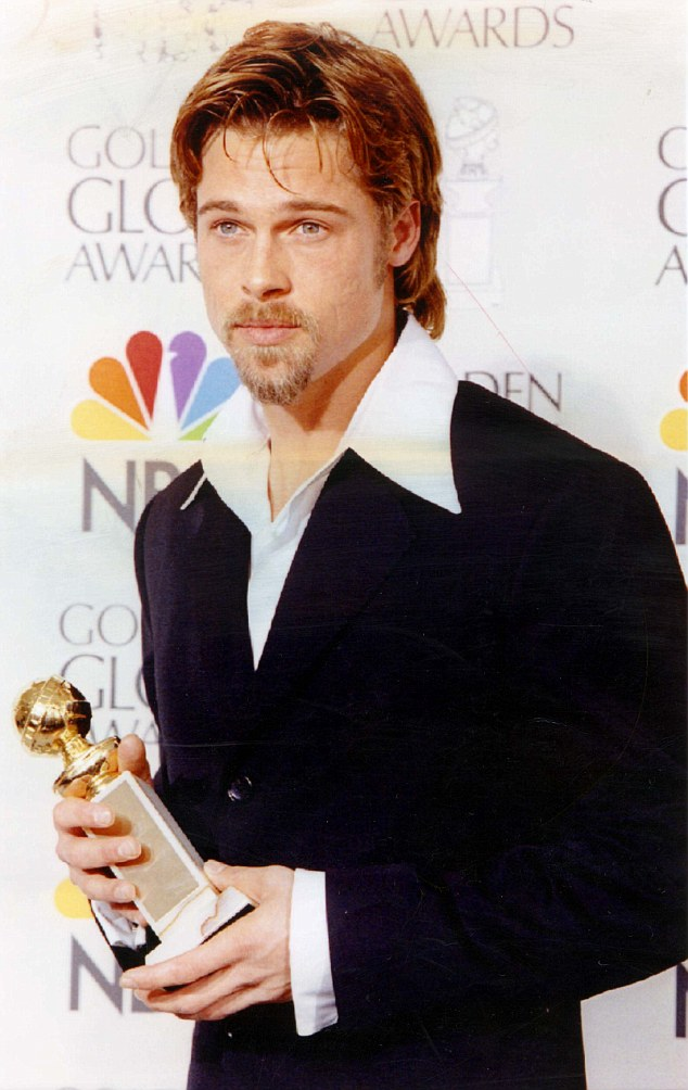 PKT3721-269308 ACTOR - BRAD PITT 1996 American actor Brad Pitt holds his Best Supporting Actor-Motion Picture Award he recieved at the 53rd Annual Globe Globes Awards in Beverly Hills, California for his role in '12 MONKEYS'.