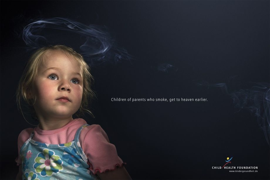 Pointing to the dangers of secondhand smoke with a beautiful child.