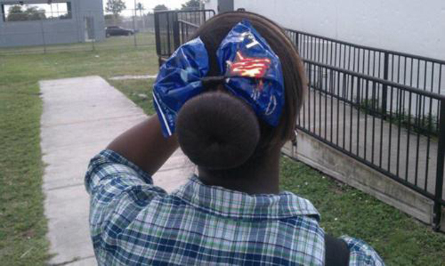 This girl wearing a Doritos bag in her hair.