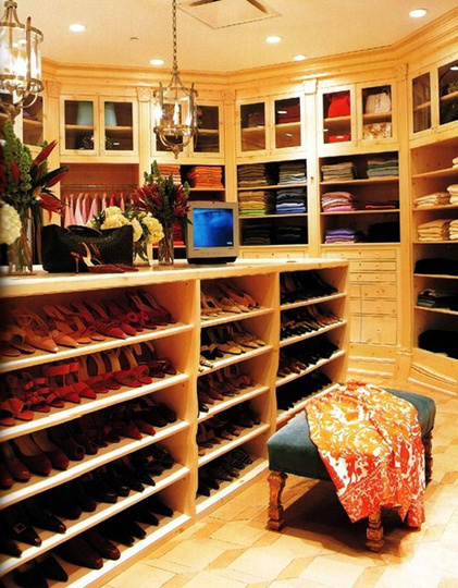 Oprah Winfrey's closet is grandiose and hyper-organized -- even her t-shirts are organized by color.