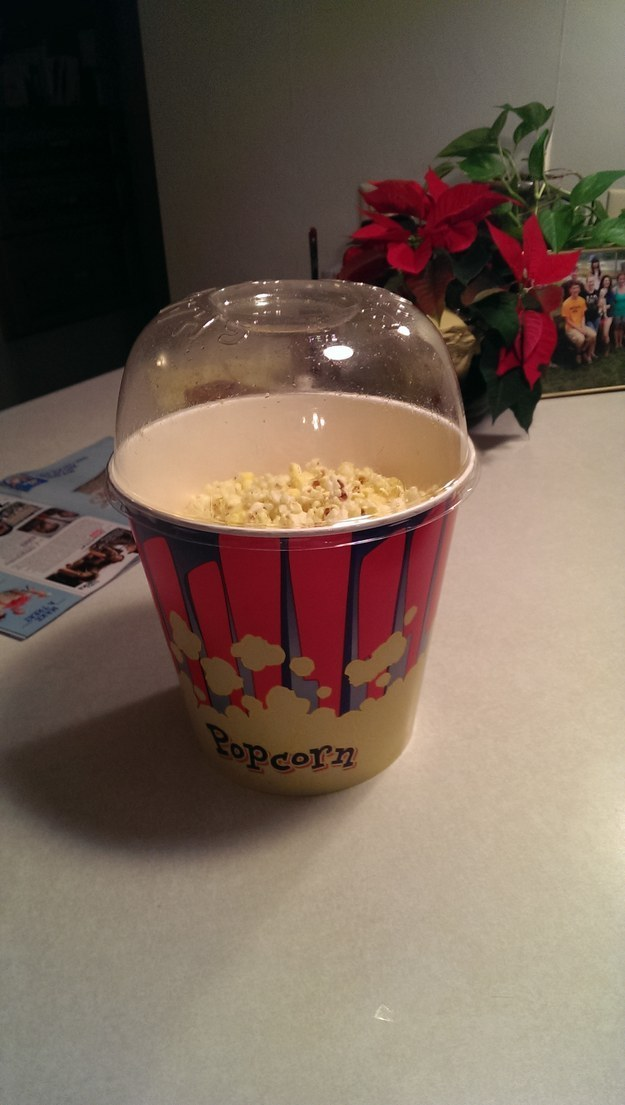 And this popcorn bucket that comes with a lid you can use to shake butter all over it AND as a bowl.