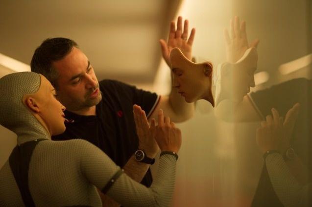 Ex Machina actor Alicia Vikander going over the scene with director Alex Garland.