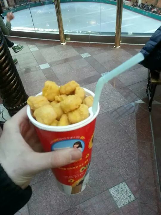 A cup that holds your drink and your nuggets.