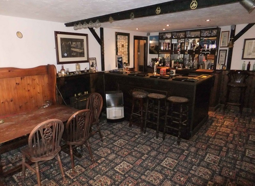 It's a totally real, functioning pub. This sold for £249,950.