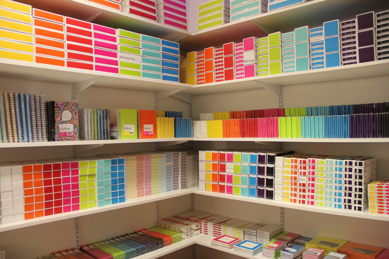 Color coordinated supply closet.