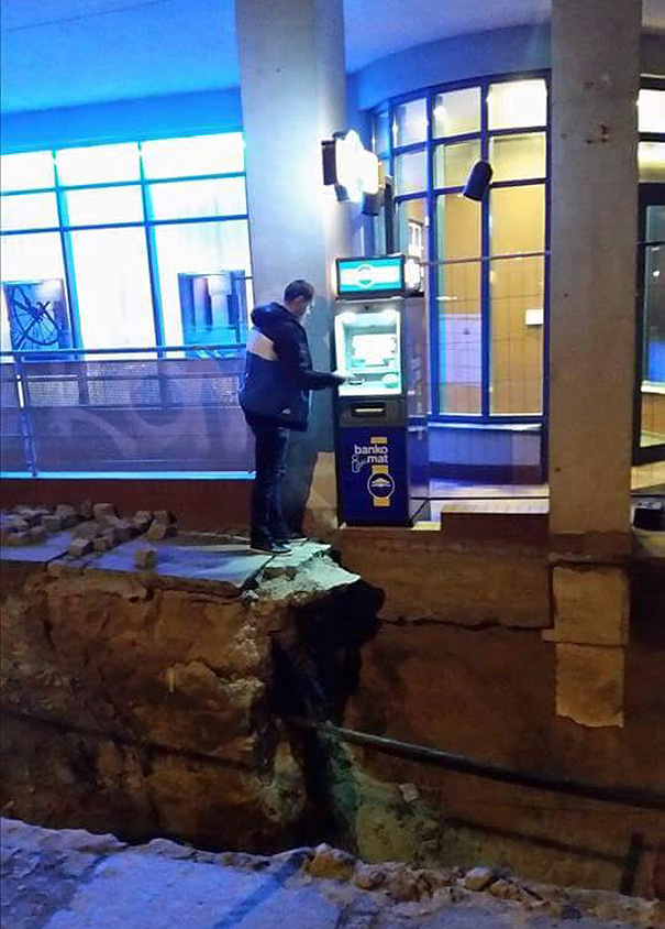 Man Withdrawing Cash From Atm In Poland
