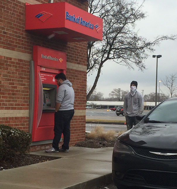 Man Withdrawing Cash From An Atm In Detroit