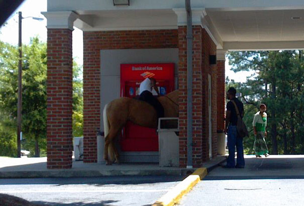 Man Withdrawing Cash From An Atm In Georgia