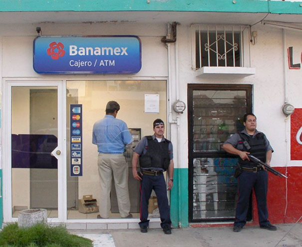 Man Withdrawing Cash From Atm In Mexico