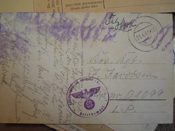 A postcard with the Nazi symbol stamped onto it. Precious.