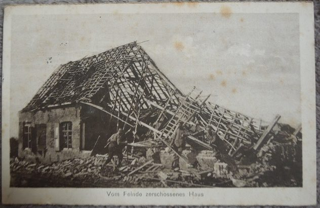 """This card is from 1944, and it reads, """"A house destroyed by the enemy."""""""