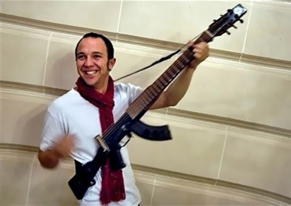 An AK-47 turned into guitar.