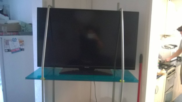 The landlord who bought a new TV but didn't take the stand size into account.