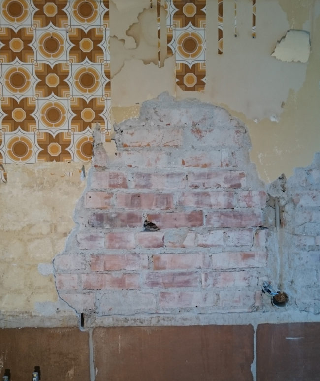 But then he noticed some bricks under the plaster that had been hidden for decades.