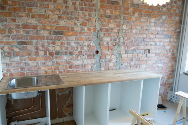 Once the brick was fully exposed, he worked on the countertop and cabinets.