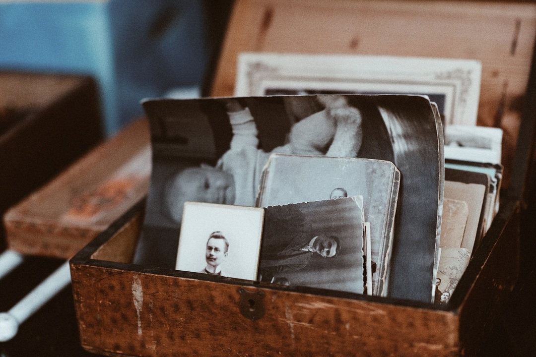 Put silica gel on your photos to preserve quality.