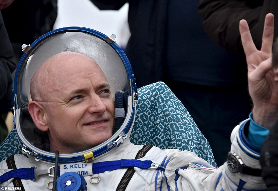 Scott Kelly, Nasa's space-endurance astronaut who returned to bitterly cold Kazakhstan on yesterday, along with his crew mate for the past year, Mikhail Kornienko. Pictured is Kelly soon after he landed back on Earth yesterday