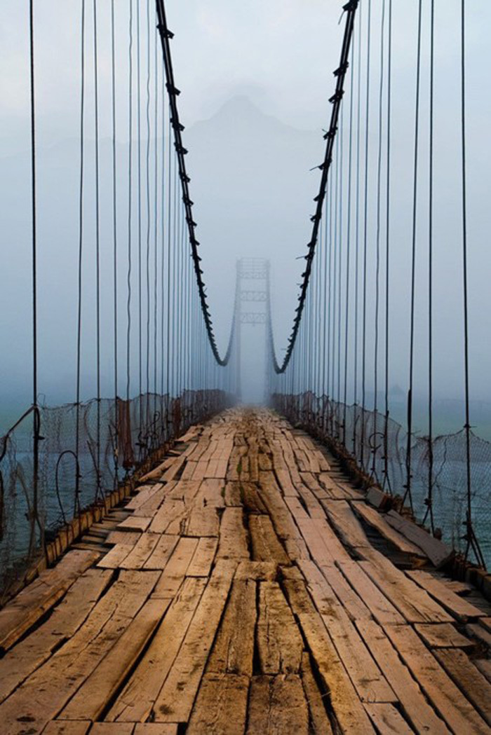 This terrifying Russian bridge has a creepy view. Even creepier: The bridge is still in use.