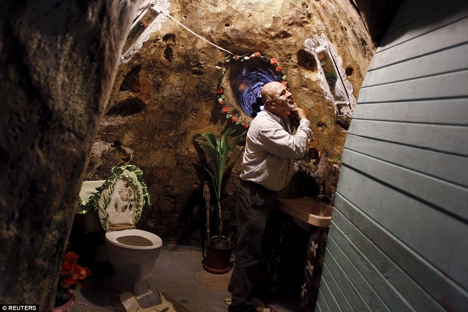 Manuel Barrantes shaves in his subterranean bathroom, which now covers about 2,000 square feet