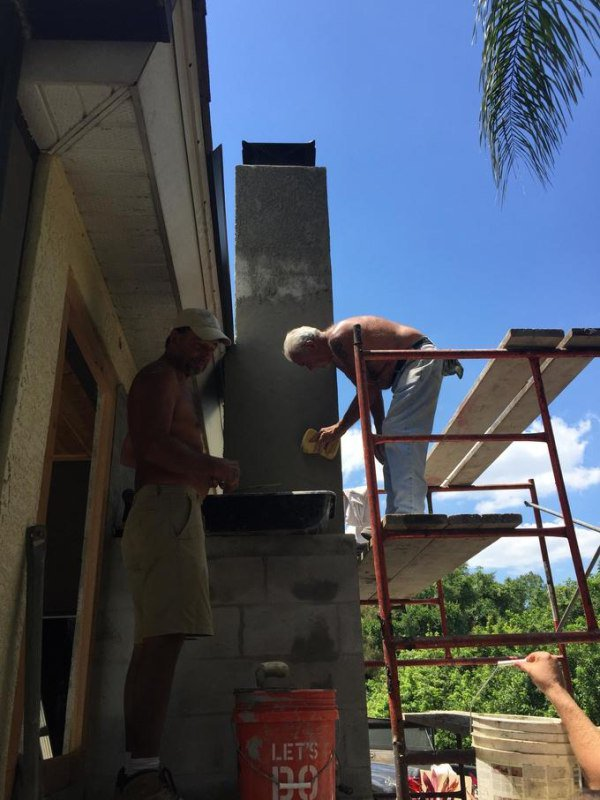 Chimney complete. Proper roof flashing installed. Masons we hired to do the block work were able to do the stucco as well. They did an amazing job.