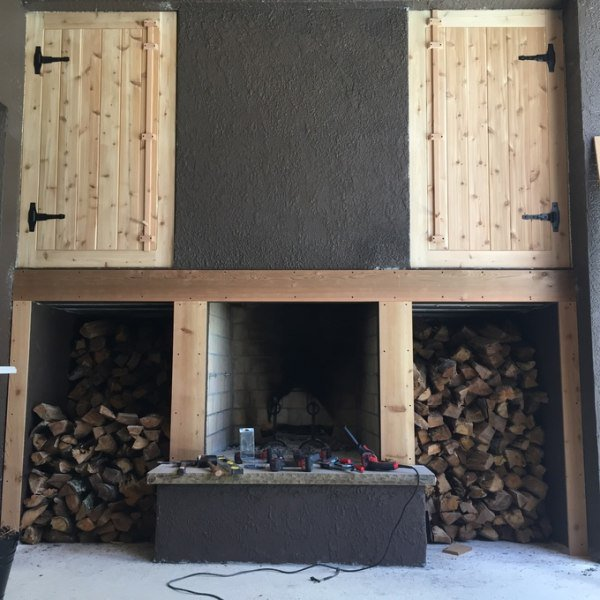 Beginning to frame in fire boxes and fireplace. Created latches for the wood doors with some scrap cedar.