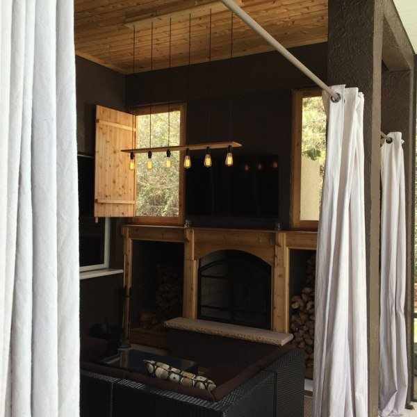 Installed privacy curtains. Put a tv above the fireplace.