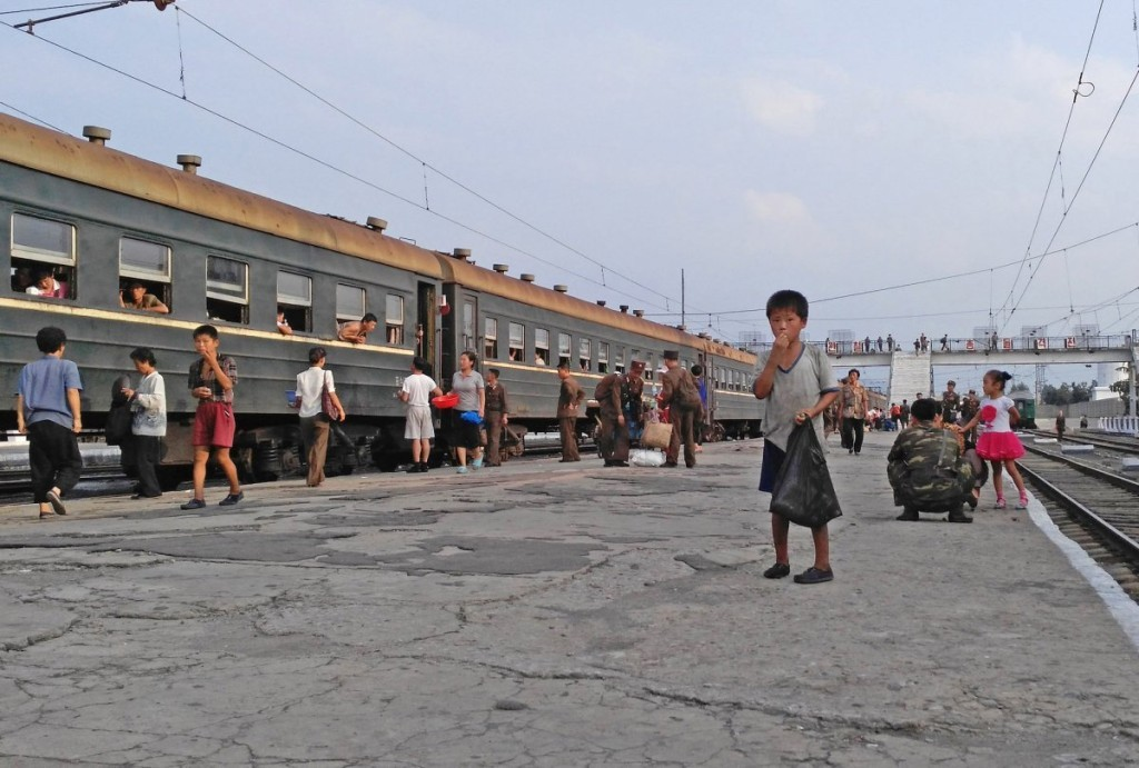 but-anytime-the-train-pulled-into-a-station-there-were-painful-reminders-of-the-poor-living-conditions-this-little-boy-begged-for-money-at-a-station-in-hamhung