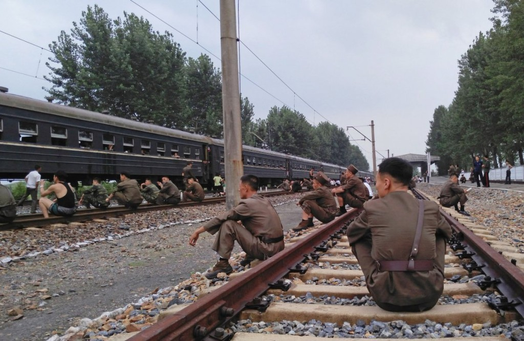 korean-peoples-army-soldiers-rested-on-the-tracks