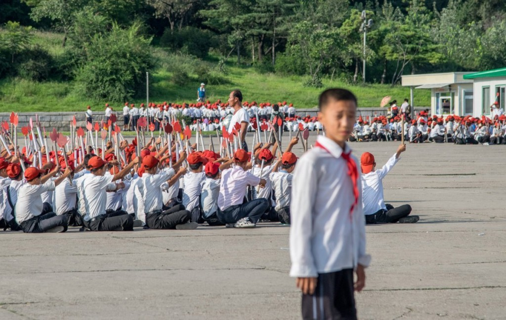 tourism-guidelines-encourage-visitors-to-take-photos-of-the-student-exercise-groups-these-kids-were-rehearsing-for-a-celebration-of-the-70th-anniversary-of-the-workers-party-of-korea