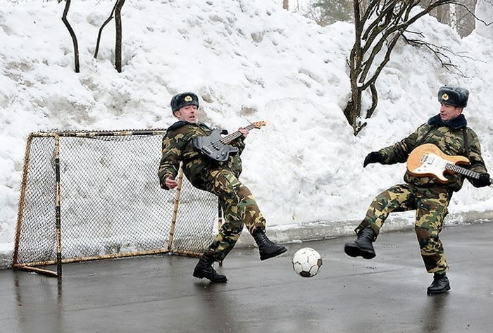 Guitars and soccer are a favorite past times of the military men.