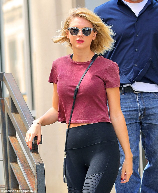 Pretty:Her blonde locks were worn down a she sported natural, make-up on her face topped off with a swipe of her signature bright red lip as she sported Clubmaster shades