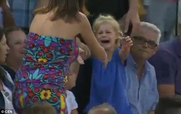 She burst into tears as her mother rushed towards her - while play remained halted