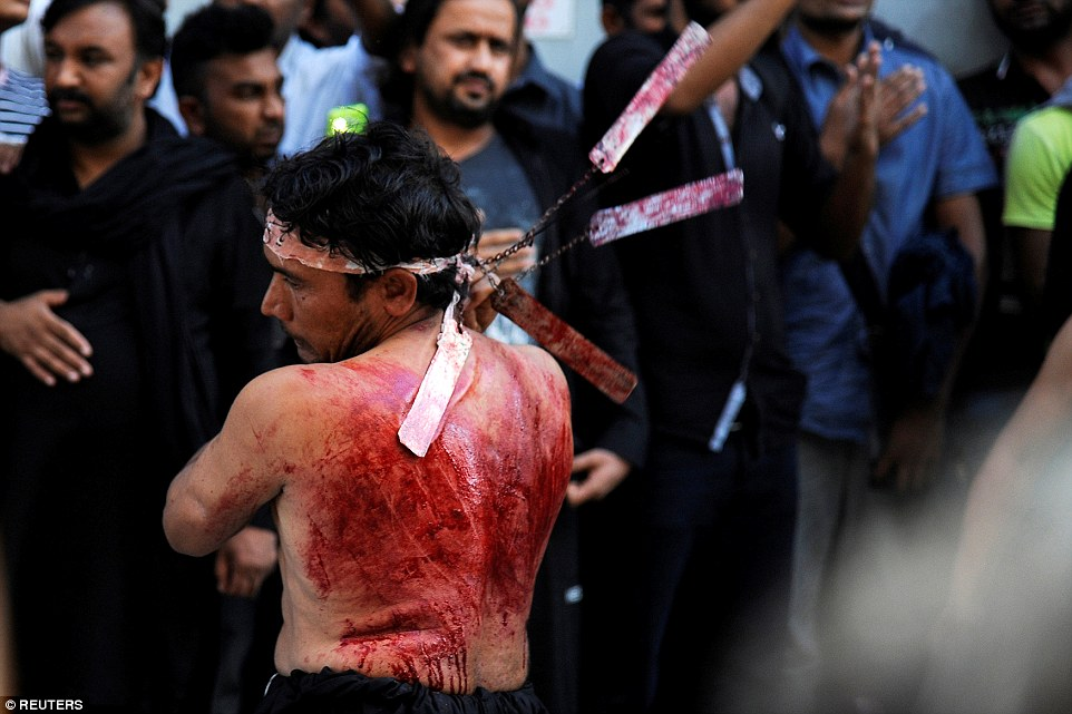 A Shiite Muslim living in Greece flagellates himself during a Muharram procession to mark Ashura in Piraeus, near Athens