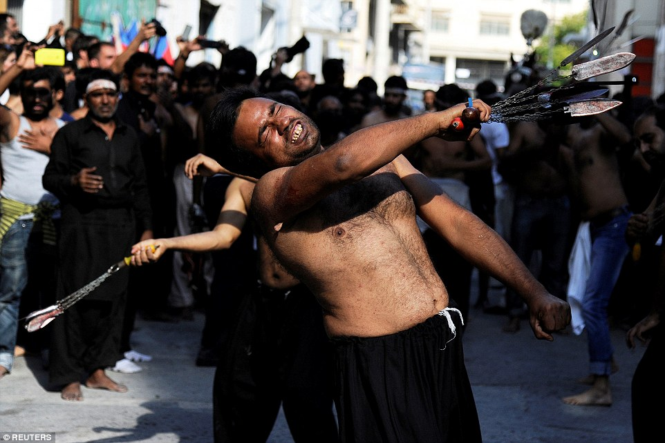 Shiite Muslims living in Greece take part in a Muharram procession to mark Ashura in Piraeus, near Athens, Greece