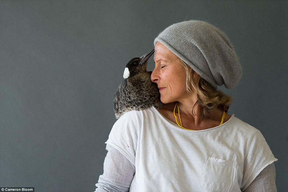 Their feathered friend dropped into their lives at a dark and difficult time, when the photographer's wife Sam (pictured) became paralysed after falling from a balcony in Thailand while on holiday