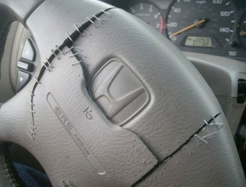 This beautifully fixed steering wheel.