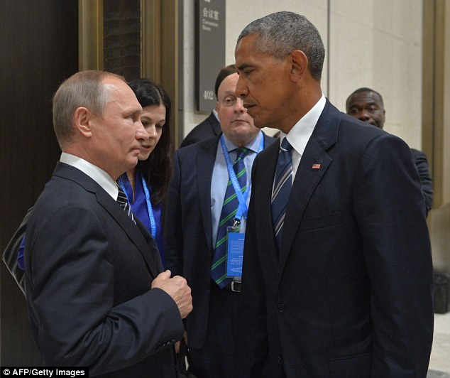 Frosty: Russian President Vladimir Putin has spoken today of the 'crisis' state of US-Russian relations, illustrated by the body language in this pictured of the leader with President Barack Obama at the G20 Leaders Summit in Hangzhou in September