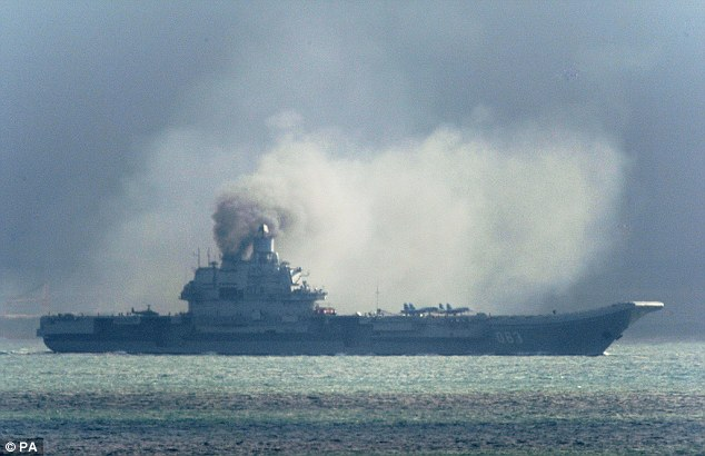 Intimidation: A Russian aircraft carrier, Admiral Kuznetsov, is part of the Russian military buildup that has convinced Nato to put 300,000 troops on alert. It was seen passing within a few miles of Dover on its way to reinforce the attack on the besieged city of Aleppo in Syria