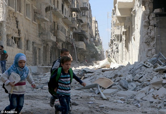 Escape: Syrian children flee from a bombsite after the Russian army attacked the opposition controlled Firdevs neighborhood in Aleppo, Syria last month. Trump's victory is likely to hasten the recapture of Aleppo by Assad, Michael Burleigh suggests