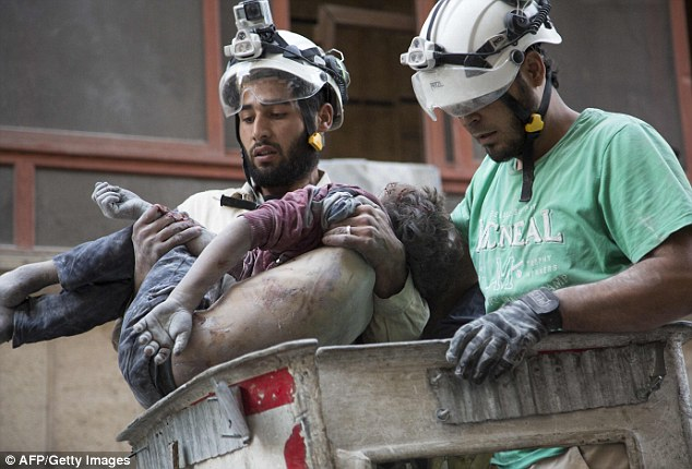 Victims: Heartbroken Syrian rescuers hold the body of a girl after pulling her from rubble of a building following a government forces air strike in the rebel-held neighbourhood of Al-Shaar in Aleppo in September. Trump's triumph is likely to have repercussions for the civilians of Aleppo