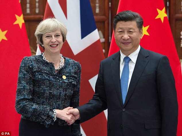 Distant: China and Britain's relationship has come under strain but Donald Trump's victory is likely to be welcomed by Chinese President Xi Jinping, who is pictured above with prime minister Theresa May