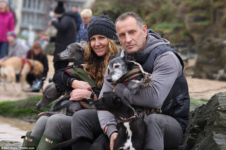 Hordes of well-wishers, many accompanied by their own dogs, joined Mark and his family on a wind swept Porth beach in Newquay for Walnut's emotional farewell