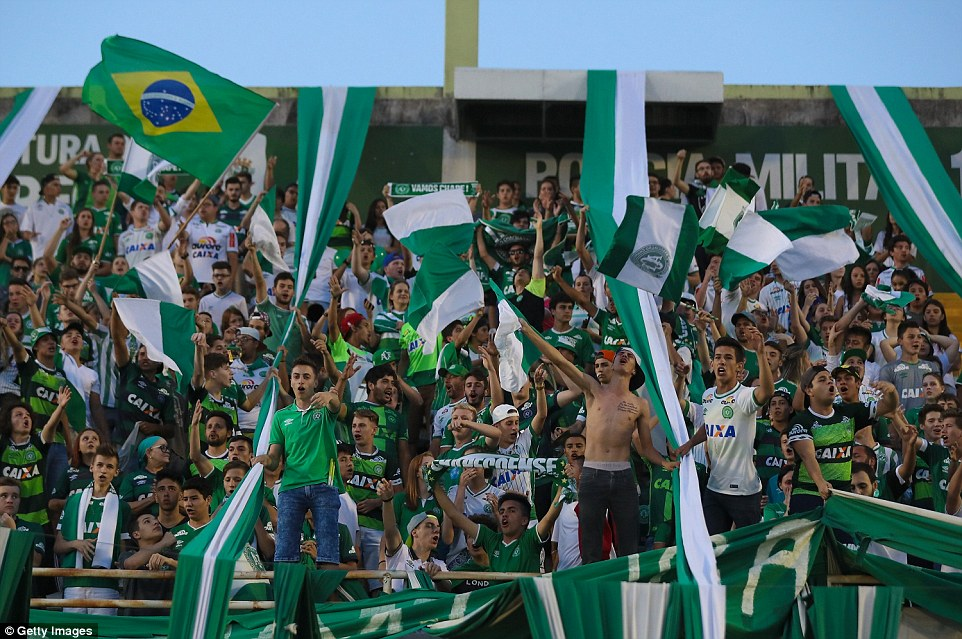 Poignant: Fans pay tribute to the players of Brazilian team Chapecoense Real at the club's Arena Conda stadium in Chapeco