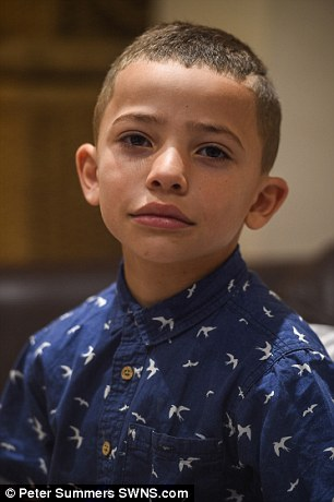 Mackenzie's parents say the school told him to cut his hair shorter, or let it grow back