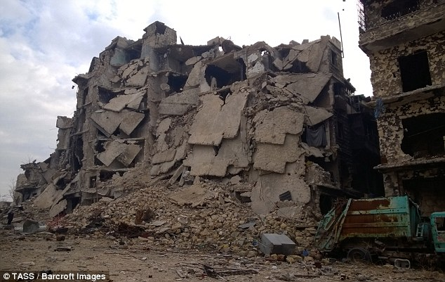 An Aleppo nurse wrote a suicide note before killing herself so Syrian soldiers could not 'savour' raping her, it has been reported. Pictures show the ruins of Aleppo