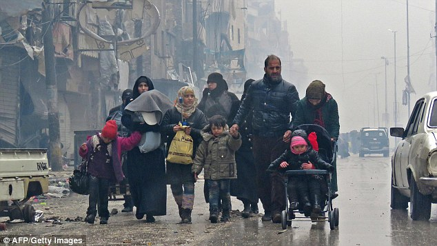 The heartbreaking note emerged as a truce aimed at safely evacuating thousands of civilians and rebel fighters from Aleppo came to a deadly end this morning. Residents are pictured fleeing the city yesterday
