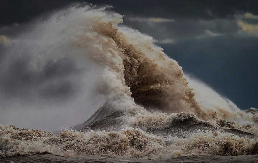 """He said his sports photography and his waves series share one important characteristic. """"In all the things I've made my living doing in photography there are no do-overs no re-dos. You get one shot at it and that's it, so it really helps you hone your craft."""""""